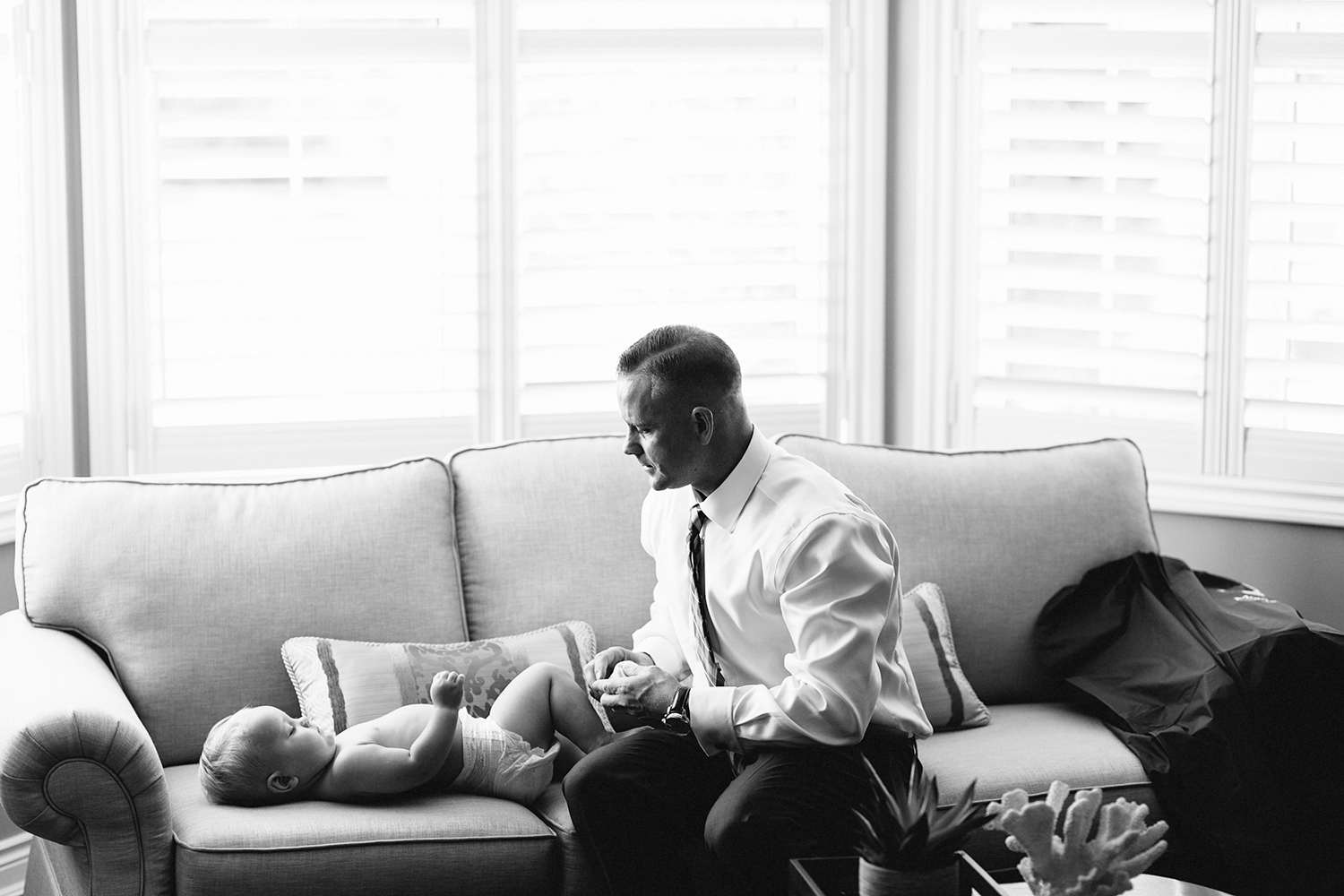 Photojournalistic-Wedding-Photographers-in-Toronto-Candid-Natural-Dowswell-Barn-Wedding-Rustic-GTA-Muskoka-Farm-Groom-getting-ready-blue-suit-dressing-his-cute-kid.jpg