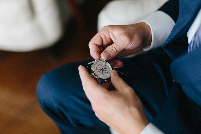 Photojournalistic-Wedding-Photographers-in-Toronto-Candid-Natural-Dowswell-Barn-Wedding-Rustic-GTA-Muskoka-Farm-Groom-getting-ready-surprise-gift-watch-from-bride-details.jpg