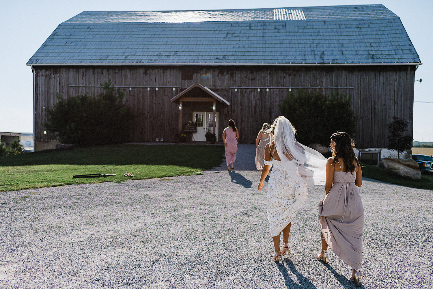 dowswell-barn-wedding-beaverton-best-wedding-photographers-toronto-moody-style-candid-photojounalistic-approach-intimate-vintage-farm-wedding-Farm-wedding-bride-entrance.jpg