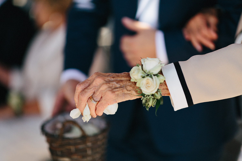 Photojournalistic-Wedding-Photographers-in-Toronto-Candid-Natural-Dowswell-Barn-Wedding-Rustic-GTA-Muskoka-Farm-details-grandma-as-flower-girl-walking-down-the-aisle-flowers.jpg