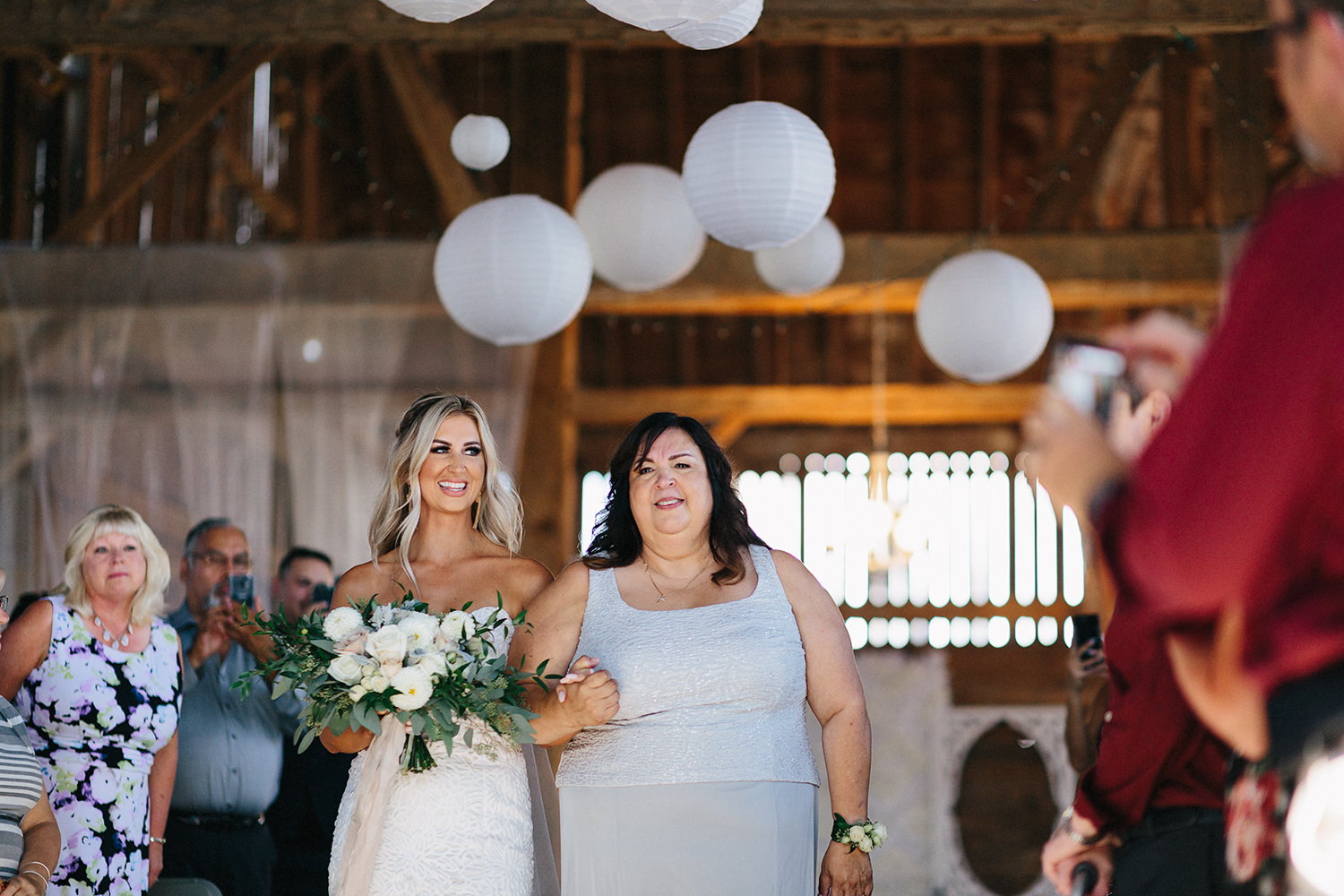 Photojournalistic-Wedding-Photographers-in-Toronto-Candid-Natural-Dowswell-Barn-Wedding-Rustic-GTA-Muskoka-Farm-ceremony-groom-waiting-for-bride-emotional-crying-love-actually-bride-in-lace-dress-smiling.jpg