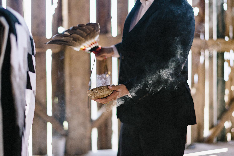 dowswell-barn-wedding-beaverton-best-wedding-photographers-toronto-moody-style-candid-photojounalistic-approach-intimate-vintage-farm-wedding-Farm-wedding-venue-details-ceremony-bride-and-groom-aboriginal-traditional-ceremony.jpg