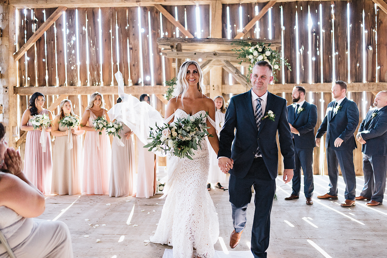 dowswell-barn-wedding-beaverton-best-wedding-photographers-toronto-moody-style-candid-photojounalistic-approach-intimate-vintage-farm-wedding-Farm-wedding-venue-details-ceremony-bride-and-groom-exit.jpg