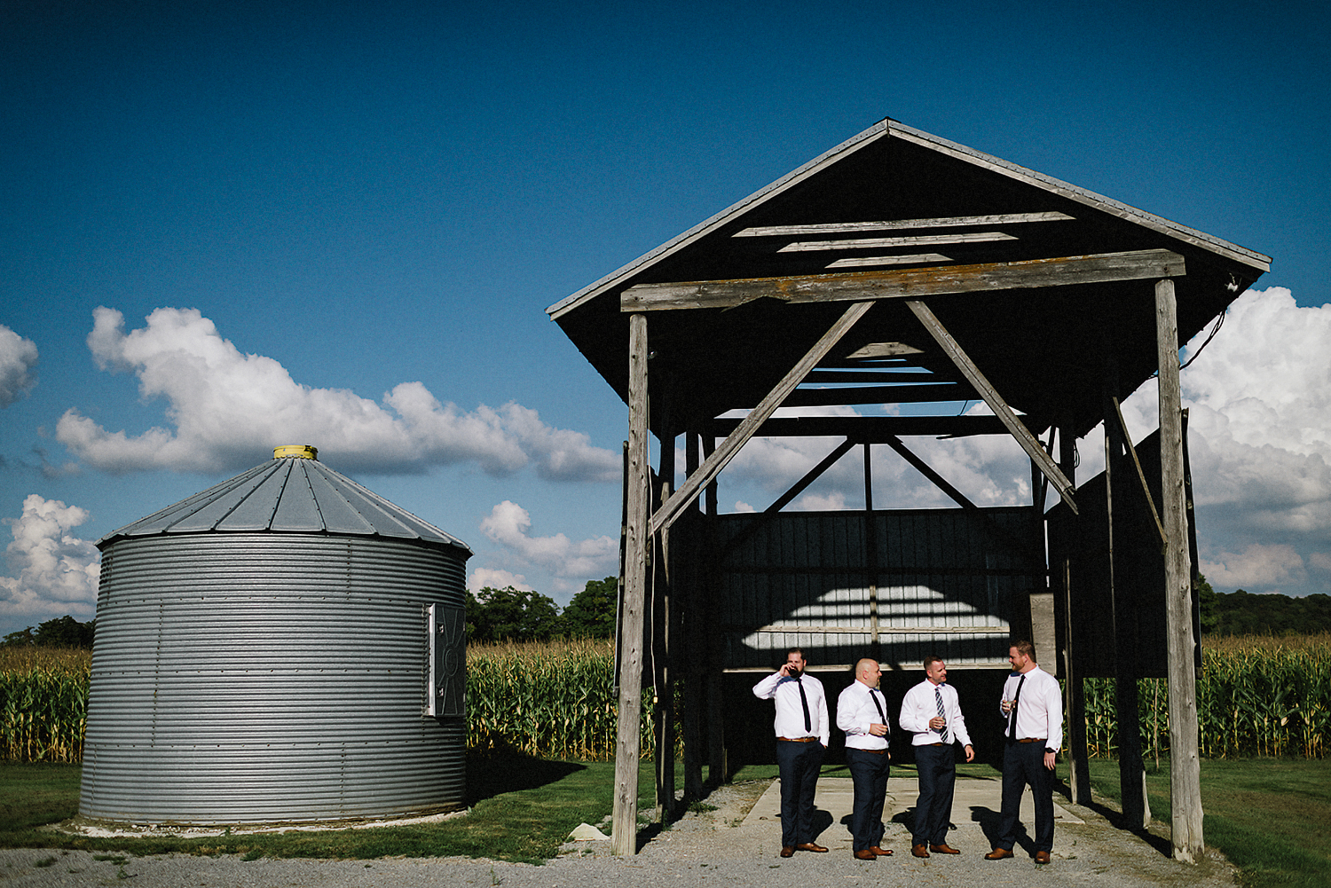 dowswell-barn-wedding-beaverton-best-wedding-photographers-toronto-moody-style-candid-photojounalistic-approach-intimate-vintage-farm-wedding-Farm-wedding-bridal-party-groomsmen-candid-drinks-cinematic.jpg