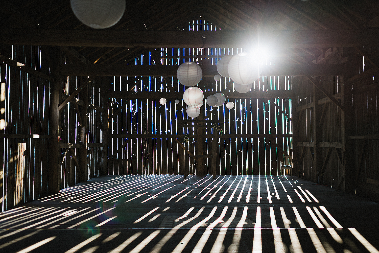 dowswell-barn-wedding-beaverton-best-wedding-photographers-toronto-moody-style-candid-photojounalistic-approach-intimate-vintage-farm-wedding-Farm-wedding-bridal-party-groomsmen-candid-guests-cocktail-hour-light-in-venue.jpg