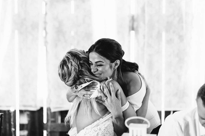 Documentary-Wedding-Photographers-in-Toronto-Candid-Natural-Dowswell-Barn-Wedding-Rustic-GTA-Muskoka-Farm-romantic-barn-golden-light-speeches-bridesmaid-moh-cute-bride-hugging-bw.jpg