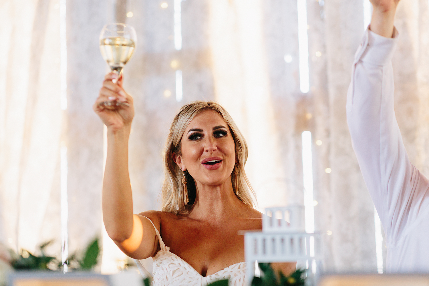 Documentary-Wedding-Photographers-in-Toronto-Candid-Natural-Dowswell-Barn-Wedding-Rustic-GTA-Muskoka-Farm-romantic-barn-golden-light-speeches-bridesmaid-moh-cute-bride-cheers-toast.jpg
