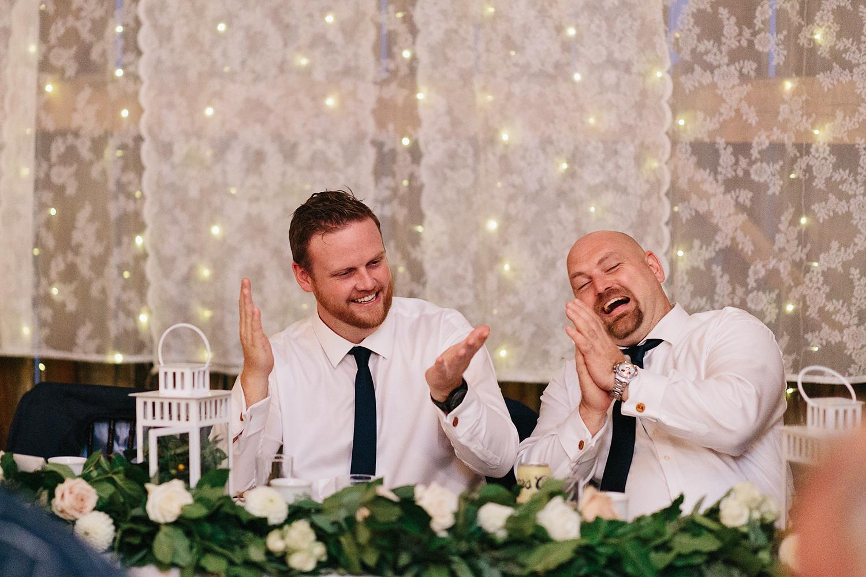 Documentary-Wedding-Photographers-in-Toronto-Candid-Natural-Dowswell-Barn-Wedding-Rustic-GTA-Muskoka-Farm-romantic-barn-golden-light-speeches-groomsman-guests-cheering-clapping-laughing.jpg