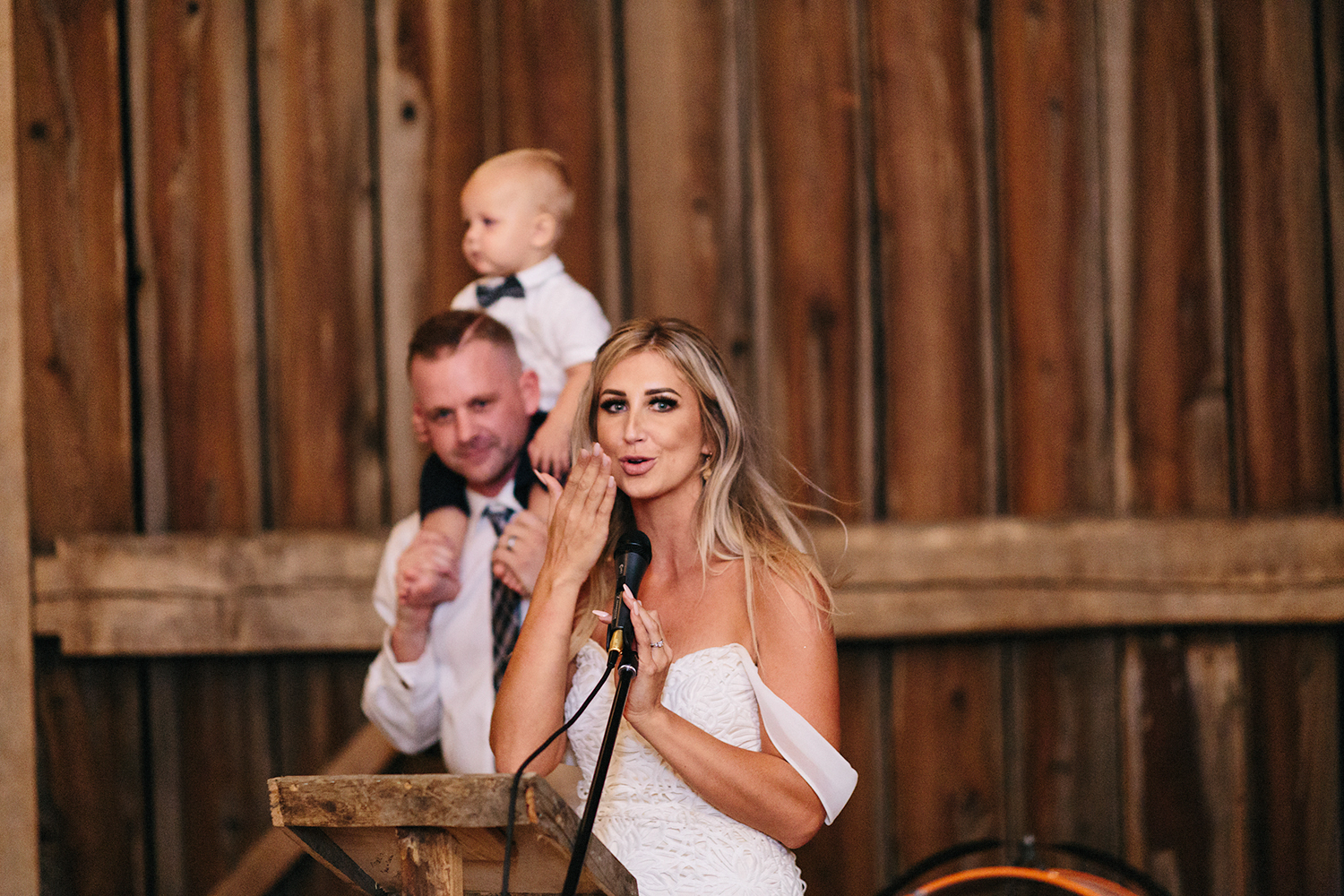 Documentary-Wedding-Photographers-in-Toronto-Candid-Natural-Dowswell-Barn-Wedding-Rustic-GTA-Muskoka-Farm-romantic-barn-golden-light-speeches-bride-and-groom-and-son-cute-candid-beautiful-memories.jpg
