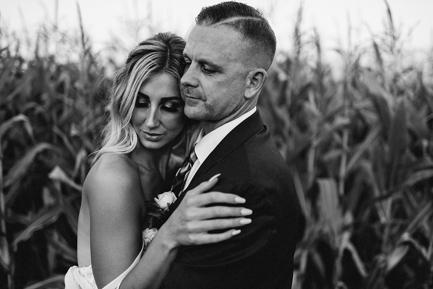 Best-Wedding-Photographers-Toronto-with-Documentary-and-photojournalistic-style-3b-Photography-Intimate-Wedding-at-Dowswell-Barn-Wedding-Photography-Bride-and-groom-intimate-wedding-couple-cornfield-pink-sunset-candid-BW.jpg
