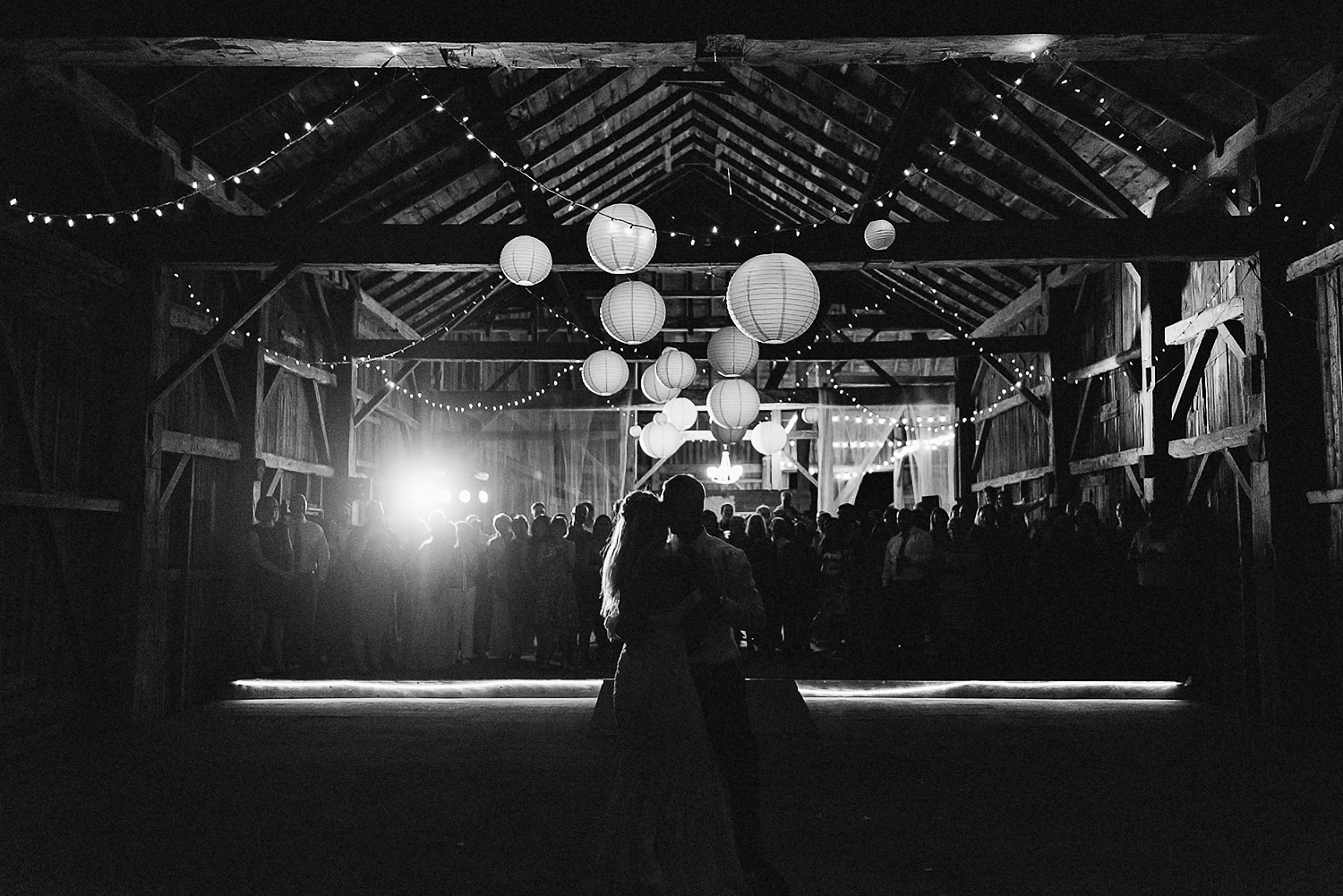 Best-Wedding-Photographers-Toronto-with-Documentary-and-photojournalistic-style-3b-Photography-Intimate-Wedding-at-Dowswell-Barn-Wedding-Photography-bride-and-groom-dancing-together-candid-emotions-moody.jpg