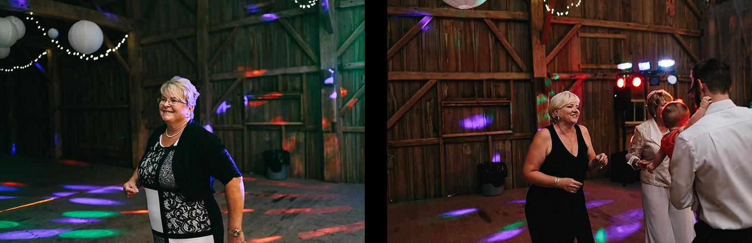 11-Documentary-Wedding-Photographers-in-Toronto-Candid-Natural-Dowswell-Barn-Wedding-Rustic-GTA-Muskoka-Farm-romantic-huge-barn-reception-party-guests-dancing-candid.jpg