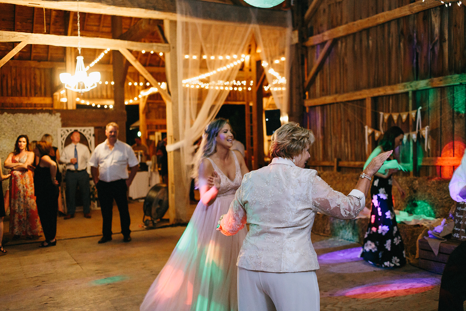 Documentary-Wedding-Photographers-in-Toronto-Candid-Natural-Dowswell-Barn-Wedding-Rustic-GTA-Muskoka-Farm-romantic-huge-barn-reception-party-bridesmaid-candid.jpg