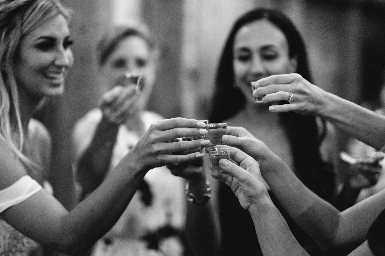 Documentary-Wedding-Photographers-in-Toronto-Candid-Natural-Dowswell-Barn-Wedding-Rustic-GTA-Muskoka-Farm-romantic-huge-barn-reception-party-bride-doing-shots.jpg