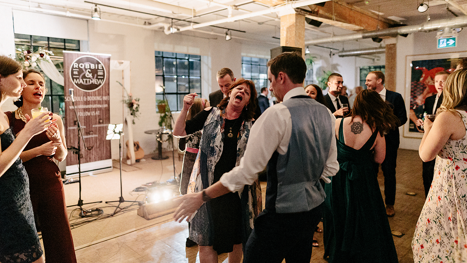 East-Room-Wedding-Queen-Street-East-Toronto-Intimate-Industrial-Wedding-Venue-Reception-Details-Grand-Electric-Food-Truck-Catering-candid-moments-wedding-photography-candid-dance-party-11.jpg