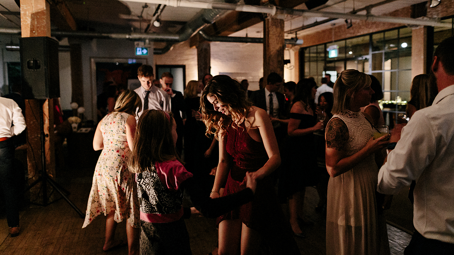 East-Room-Wedding-Queen-Street-East-Toronto-Intimate-Industrial-Wedding-Venue-Reception-Details-Grand-Electric-Food-Truck-Catering-candid-moments-wedding-photography-candid-dance-party-22.jpg
