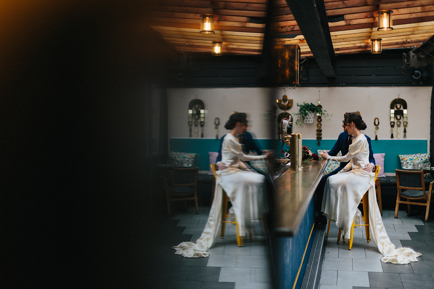 film-artistic-fine-art-weird-cool-tattooed-bride-and-groom-couples-portraits-at-the-bar-vintage-wedding-elopement-inspiration-bouquet-by-timberlost-Toronto-Elopement-at-the-Drake-Hotel-Torontos-Best-elopement-photographers-candid-documentary.jpg