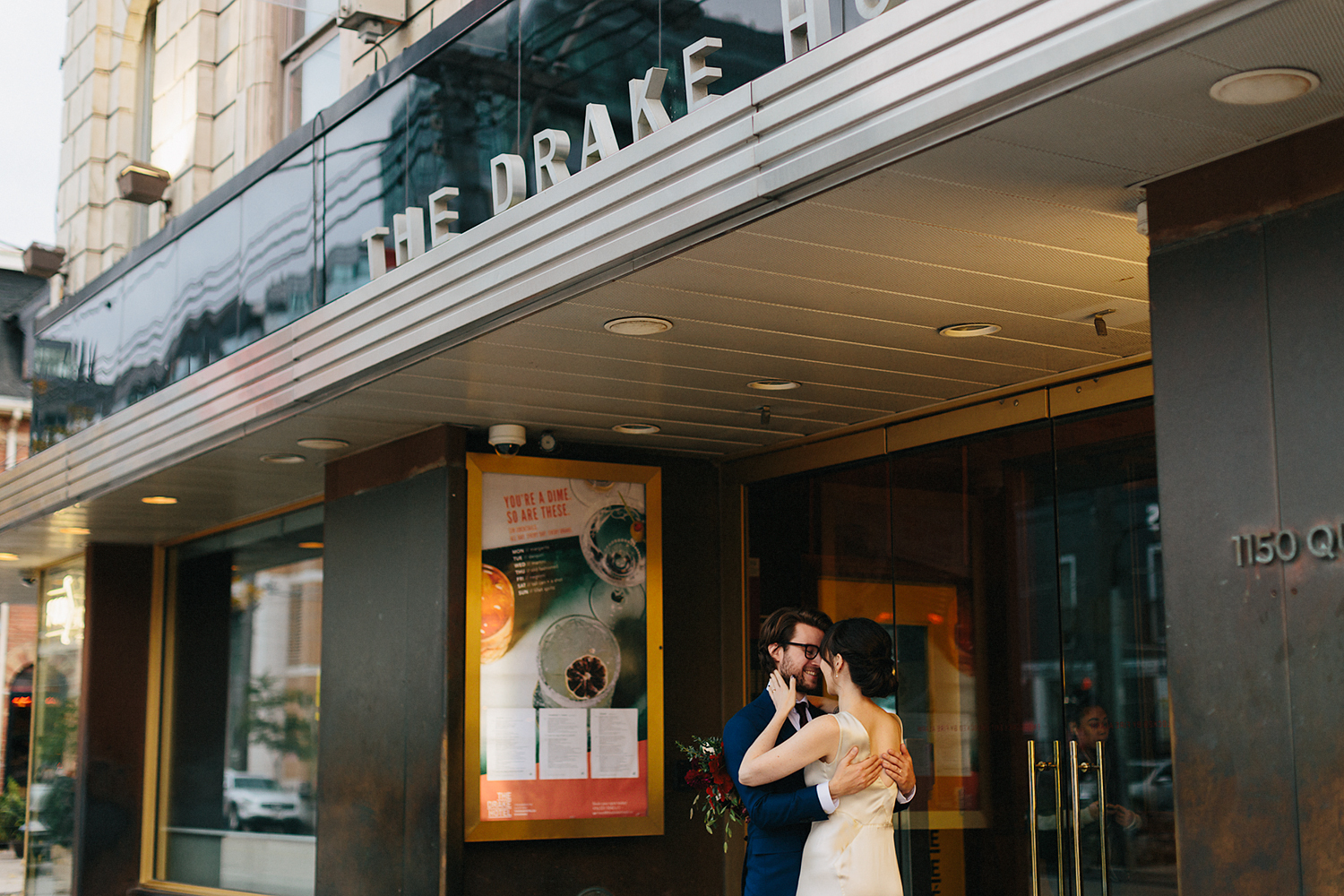 marquee-analog-editorial-tattooed-bride-and-groom-portraits-by-window-in-boutique-hotel-vintage-elopement-inspiration-bouquet-by-timberlost-Toronto-Elopement-at-the-Drake-Hotel-Torontos-Best-elopement-photographers-candid-documentary.jpg