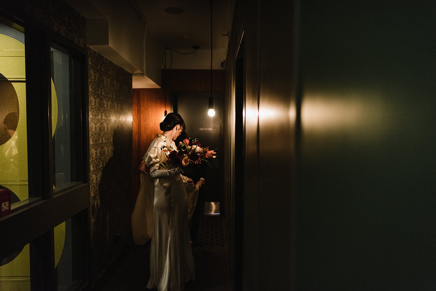 bride-and-groom-entering-together-ceremony-space-moody-candlelit-cinematic-marriage-Toronto-Elopement-at-the-Drake-Hotel-pop-up-Torontos-Best-wedding-photographers-candid-documentary-photojournalistic.jpg