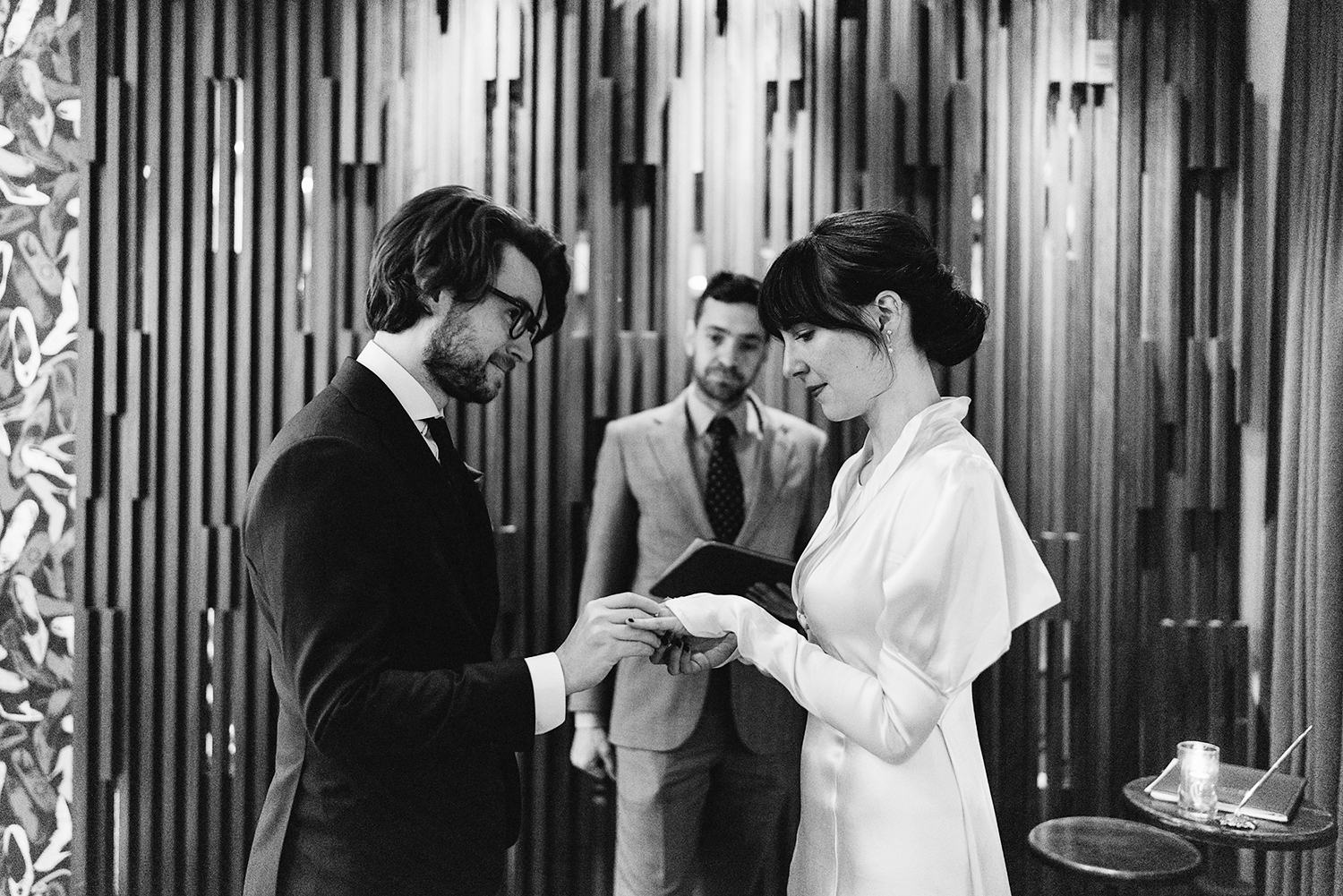 bw-film-bride-and-groom-exchanging-rings-emotional-bride-crying-ceremony-space-moody-candlelit-cinematic-Toronto-Elopement-at-the-Drake-Hotel-pop-up-Torontos-Best-wedding-photographers-candid-documentary-photojournalistic.jpg