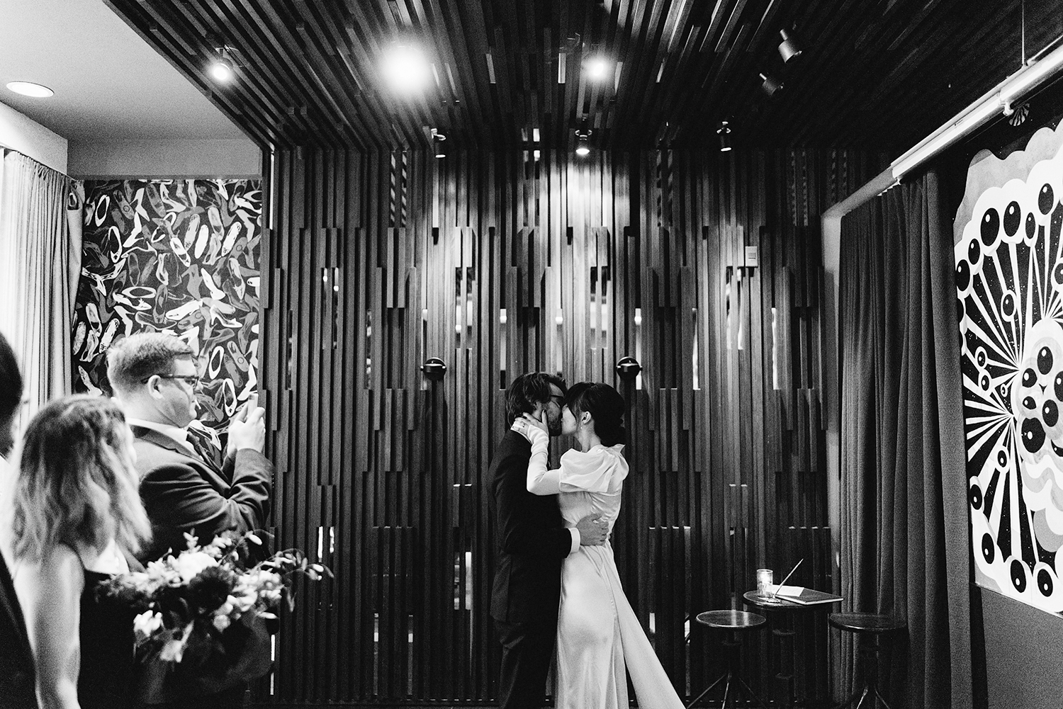 analog-film-bride-and-groom-emotional--first-kiss-ceremony-space-moody-candlelit-cinematic-Toronto-Elopement-at-the-Drake-Hotel-pop-up-Torontos-Best-wedding-photographers-candid-documentary-photojournalistic.jpg