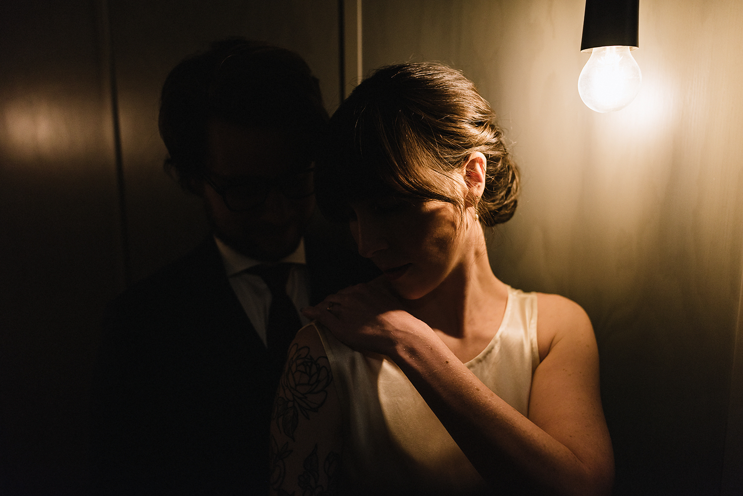 portraits-of-groom-and-bride-by-light-moody-editorial-Toronto-Elopement-at-the-Drake-Hotel-pop-up-Torontos-Best-wedding-photographers-candid-documentary-photojournalistic.jpg