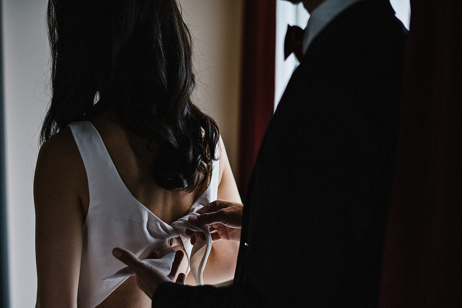 21-525-Best-Wedding-Photography-Toronto-Ontario-Canada-Photojournalistic-Genuine-Candid-Moments-Groom-Helping-Bride-Get-dressed.jpg