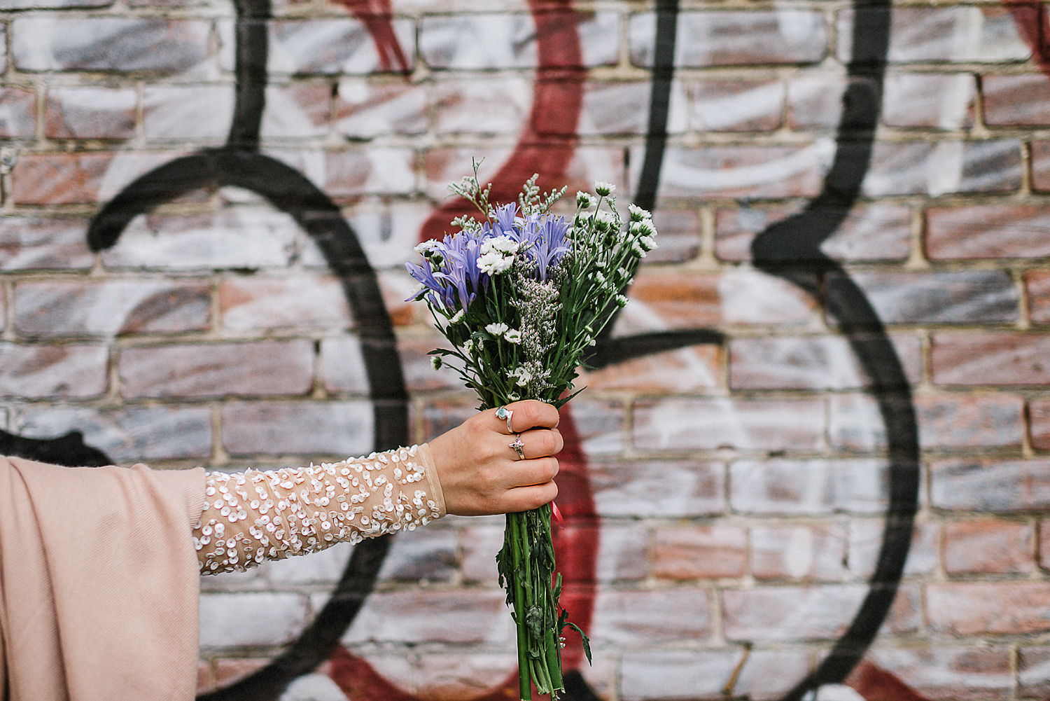 15-Toronto-City-Hall-Fall-Elopement-Indie-Altervatice-Urban-City-Bride-and-Groom_Fall-Colours-Riverdale-Downtown-Toronto-Best-Wedding-Photographers-Groom-Vintage-Suit-Candid-Portrait-Bride-and-Groom-Graffiti-Wall-Bouquet-DEtail-Bride-Hand.JPG