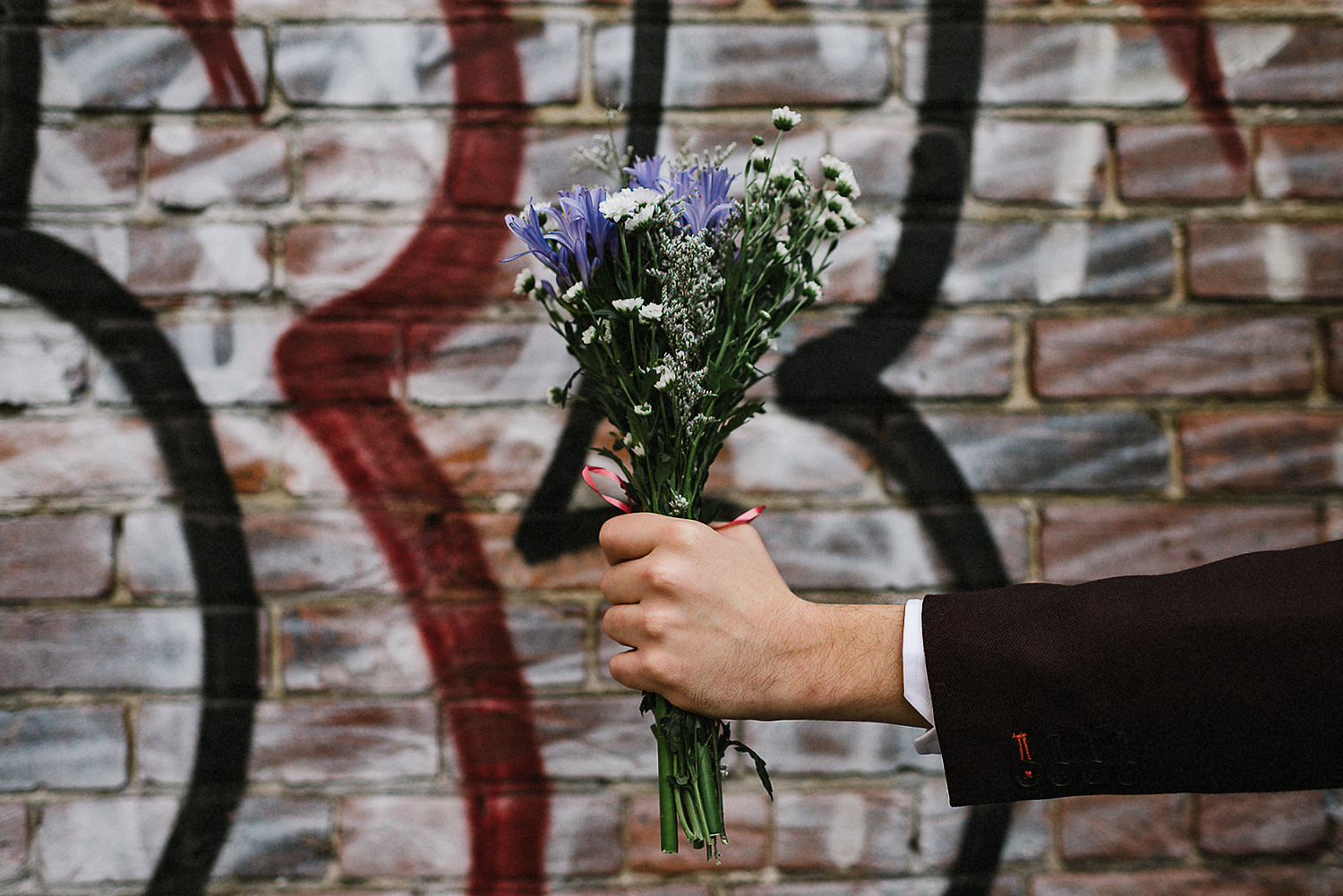 16-Toronto-City-Hall-Fall-Elopement-Indie-Altervatice-Urban-City-Bride-and-Groom_Fall-Colours-Riverdale-Downtown-Toronto-Best-Wedding-Photographers-Groom-Vintage-Suit-Candid-Portrait-Bride-and-Groom-Graffiti-Wall-Bouquet-Detail-Groom.JPG