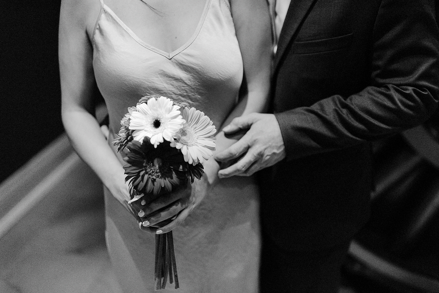 4-BEst-Wedding-Photographers-Toronto-One-King-West-Intimate-Wedding-Elopement-BW-Analog-Film-Portrait-candid-bank-vault_-Portraits-Editorial-candid-portraits-flower-bride-bouquet.jpg