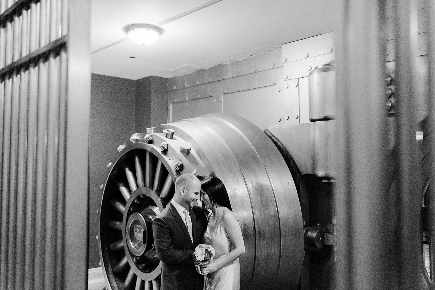 5-BEst-Wedding-Photographers-Toronto-One-King-West-Intimate-Wedding-Elopement-BW-Analog-Film-Portrait-candid-bank-vault_-Portraits-Editorial-candid-portrait.jpg
