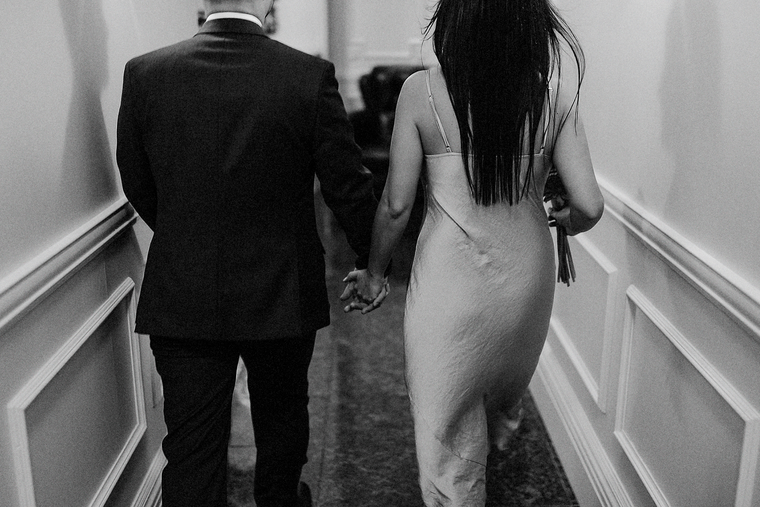 7-BEst-Wedding-Photographers-Toronto-One-King-West-Intimate-Wedding-Elopement-BW-Analog-Film-Portrait-candid-bank-vault-motion.jpg