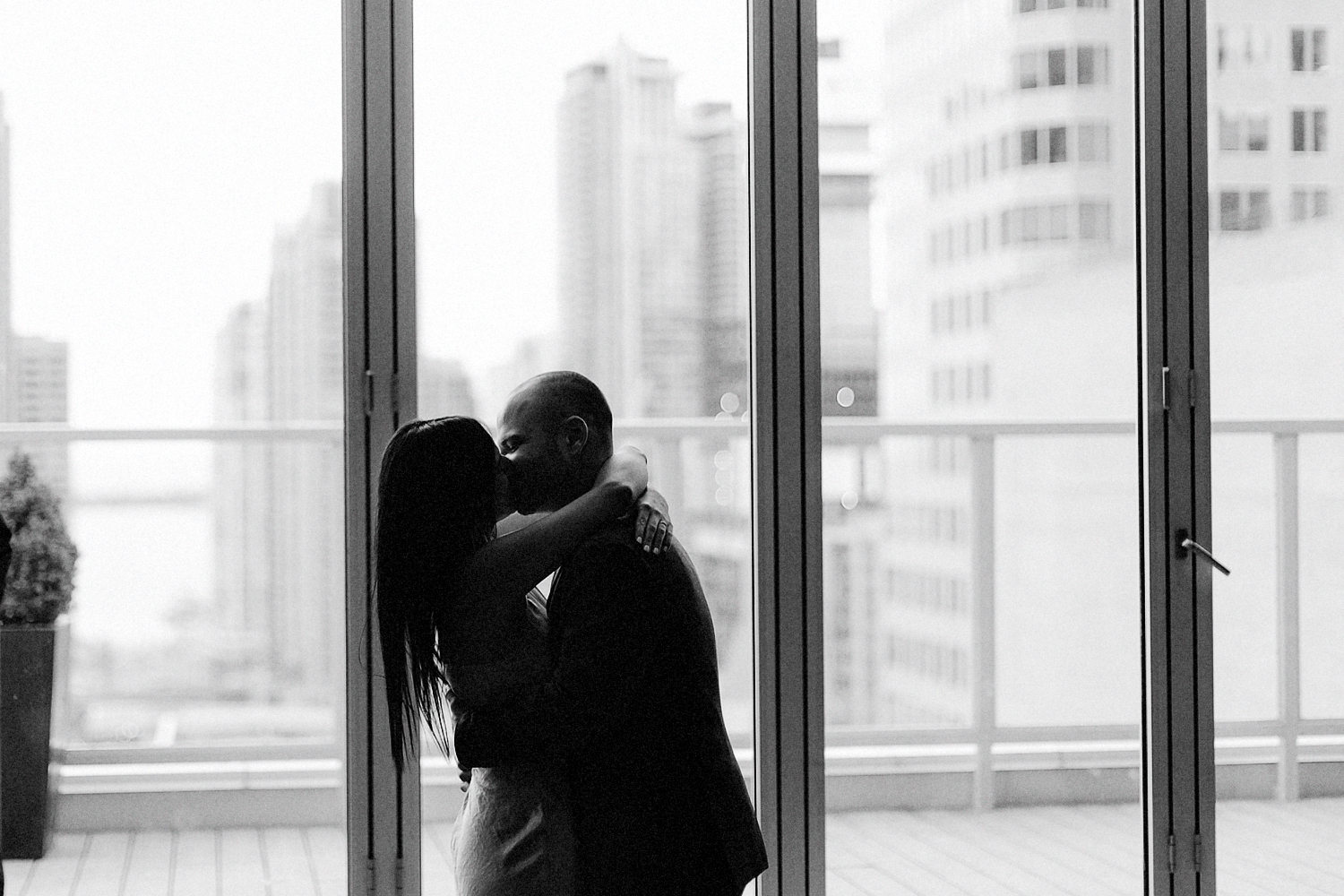 41-One-King-West-INtimate-Wedding-Ceremony-BW-Film-ANalog-Best-Wedding-Photographers-Toronto-First-Kiss.jpg