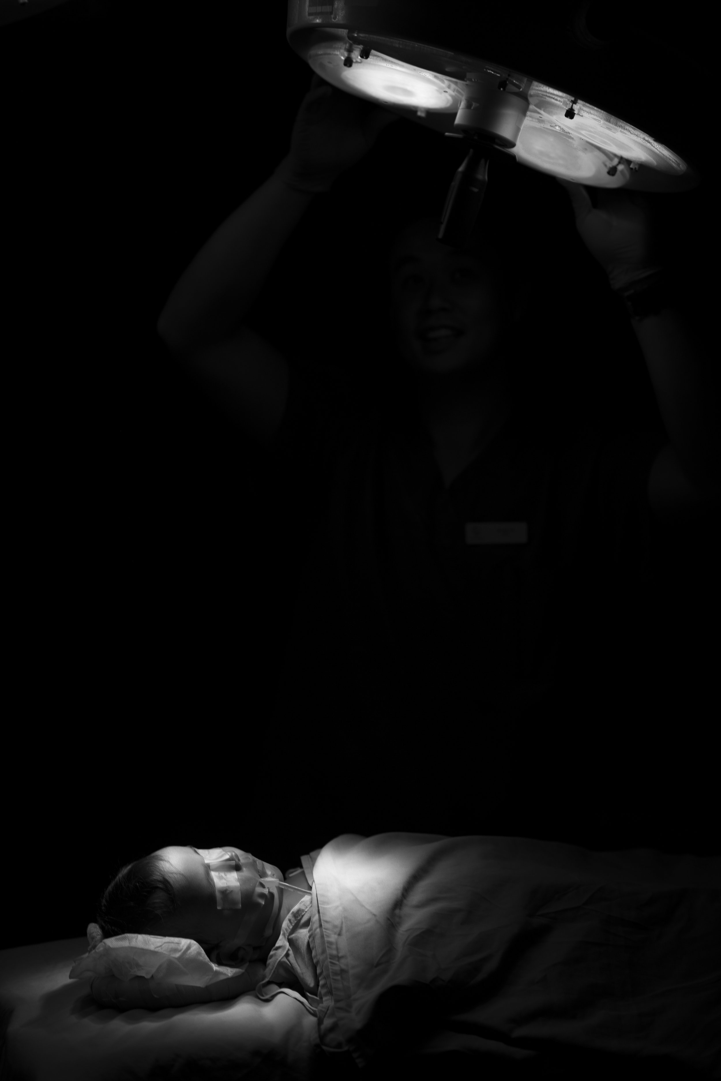 Tonga.  A young boy lies asleep in the dark waiting for surgery, whilst the team prepares out of frame. In this moment, the only sound is that of his heartbeat on the monitor. The 'stage' of a theatre is one I've become familar over the years, but I never loose the feeling of complete trust another human hands over to Doctor in this moment.