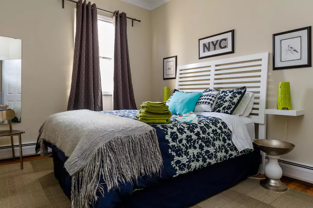 03 Large bright bedroom with queen bed.png