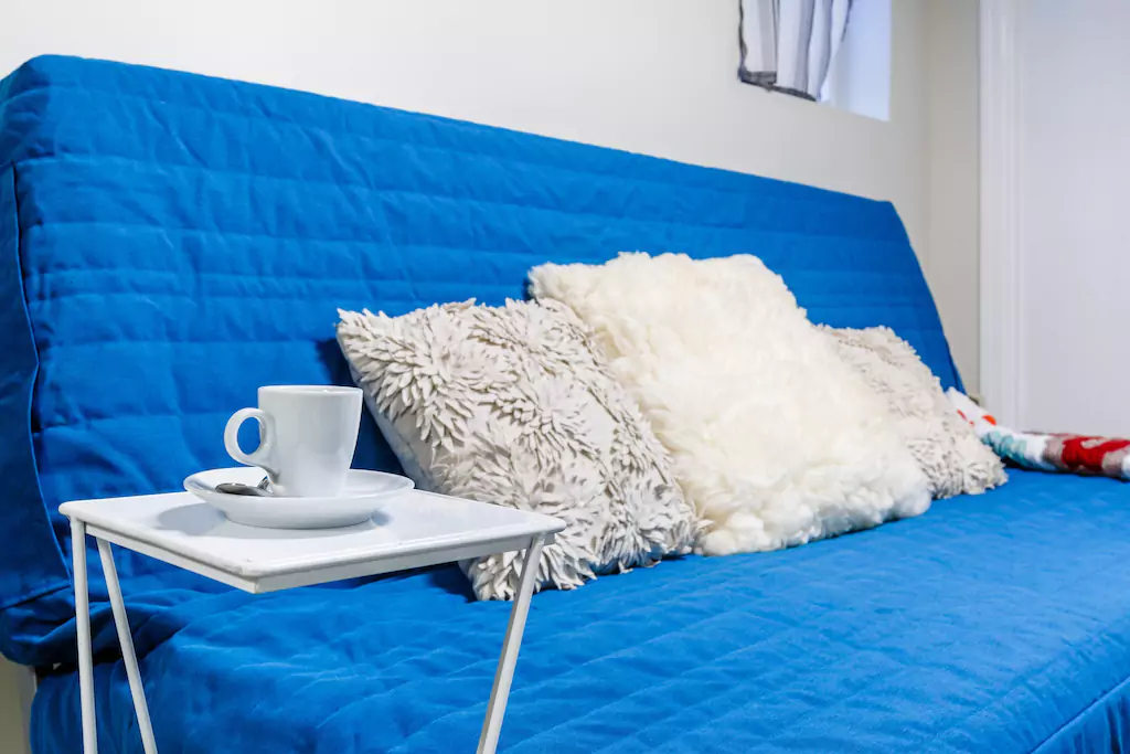 08 Futon in living area.png