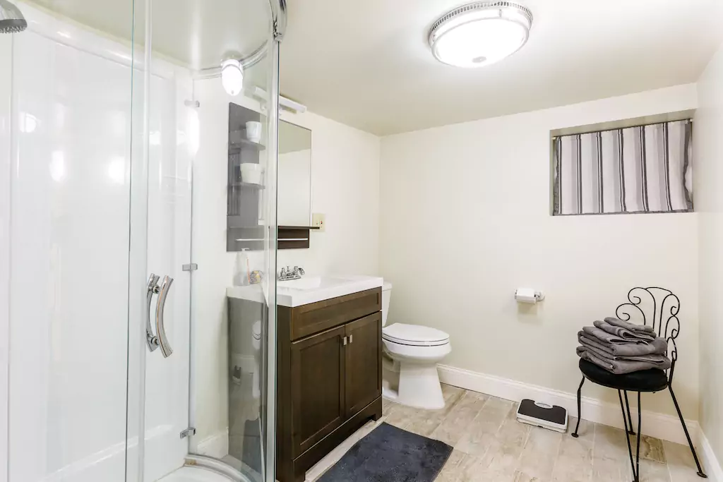 12 Bathroom with shower, sink, toilet.png