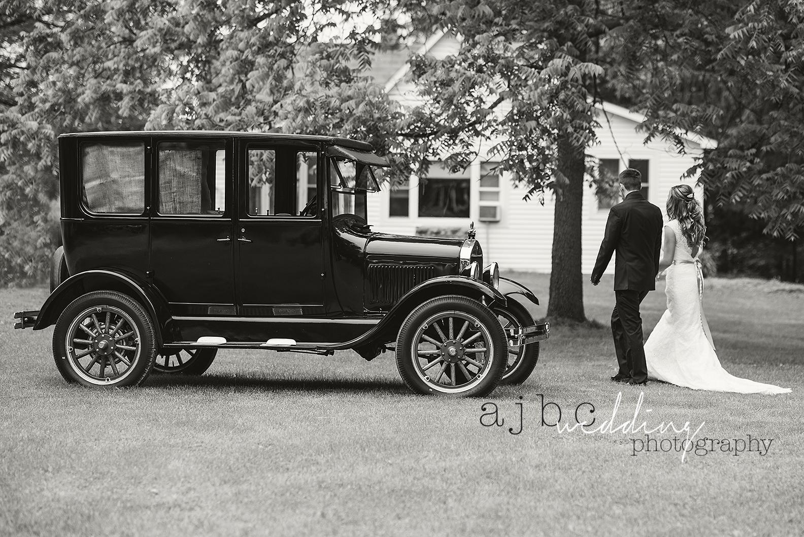 ajbcphotography-port-huron-michigan-wedding-photographer-outdoors-summer-wedding-country-wedding-wadhams-michigan-bride-groom-love-classic-car-vintage-wedding.jpg