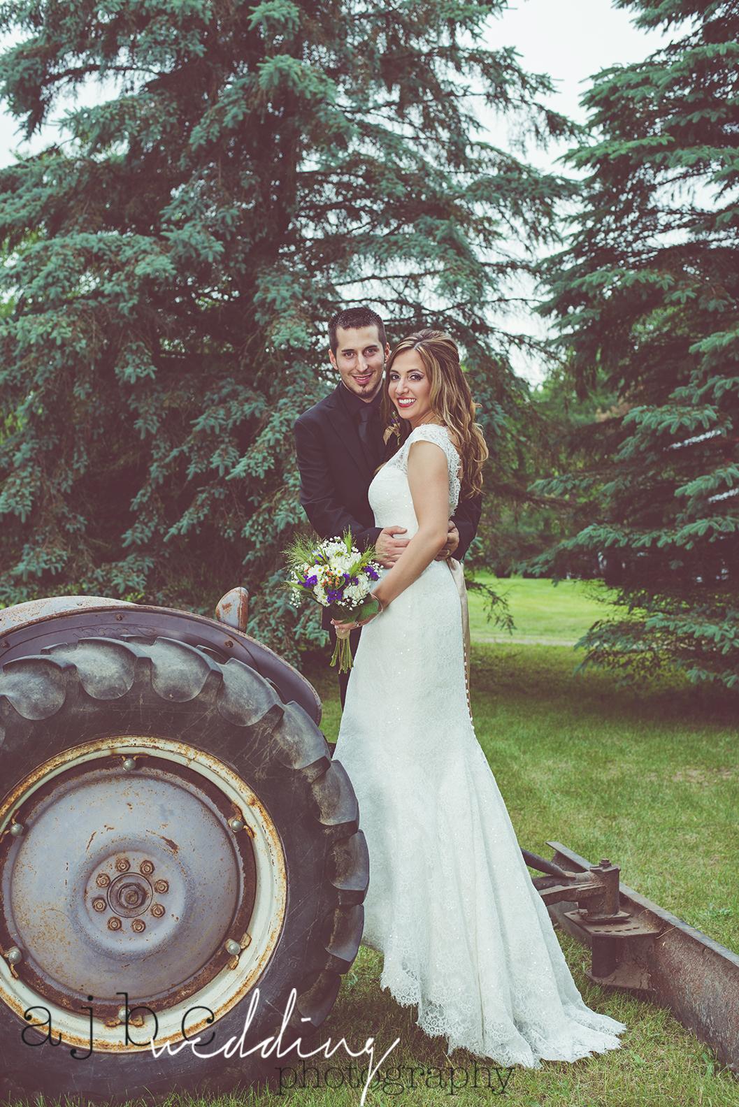 ajbcphotography-port-huron-michigan-wedding-photographer-outdoors-summer-wedding-country-wedding-wadhams-michigan-bride-vintage-wedding-tractor.jpg