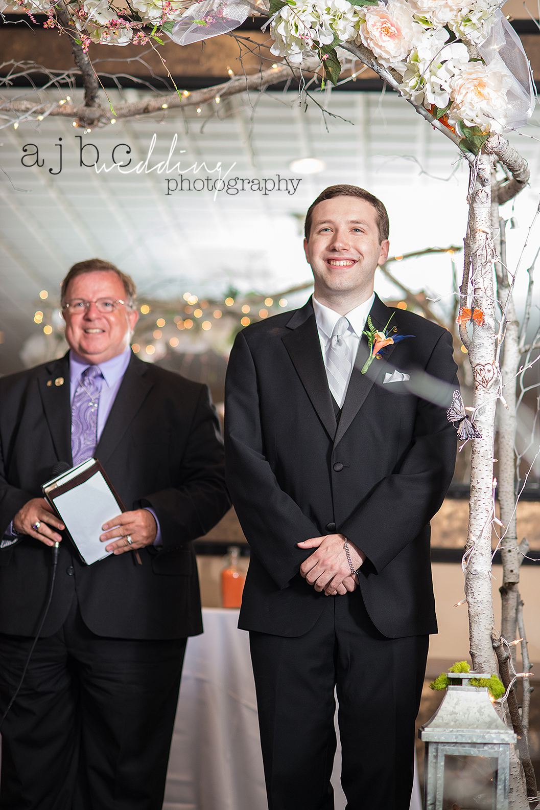 ajbcphotography-port-huron-michigan-wedding-photographer-love-bride-groom-family-michigan-wedding-photographer-walking-down-the-isle.jpg