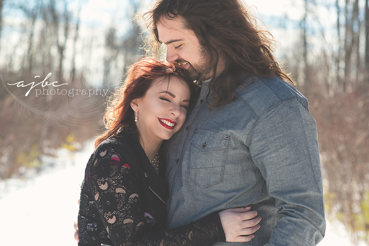 engagement couple in the snow.jpg