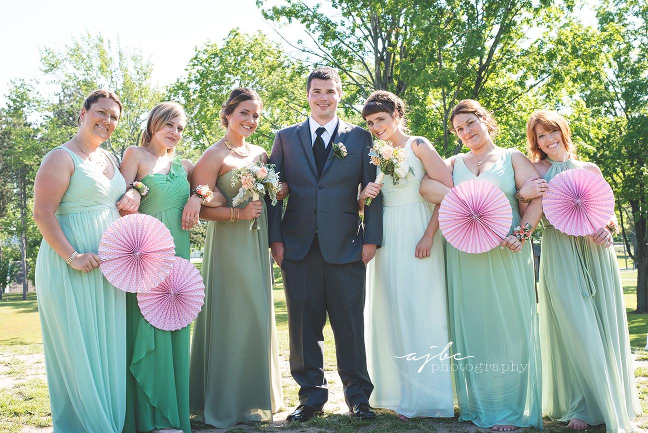 michigan wedding photographer groom and bridesmaids.jpg