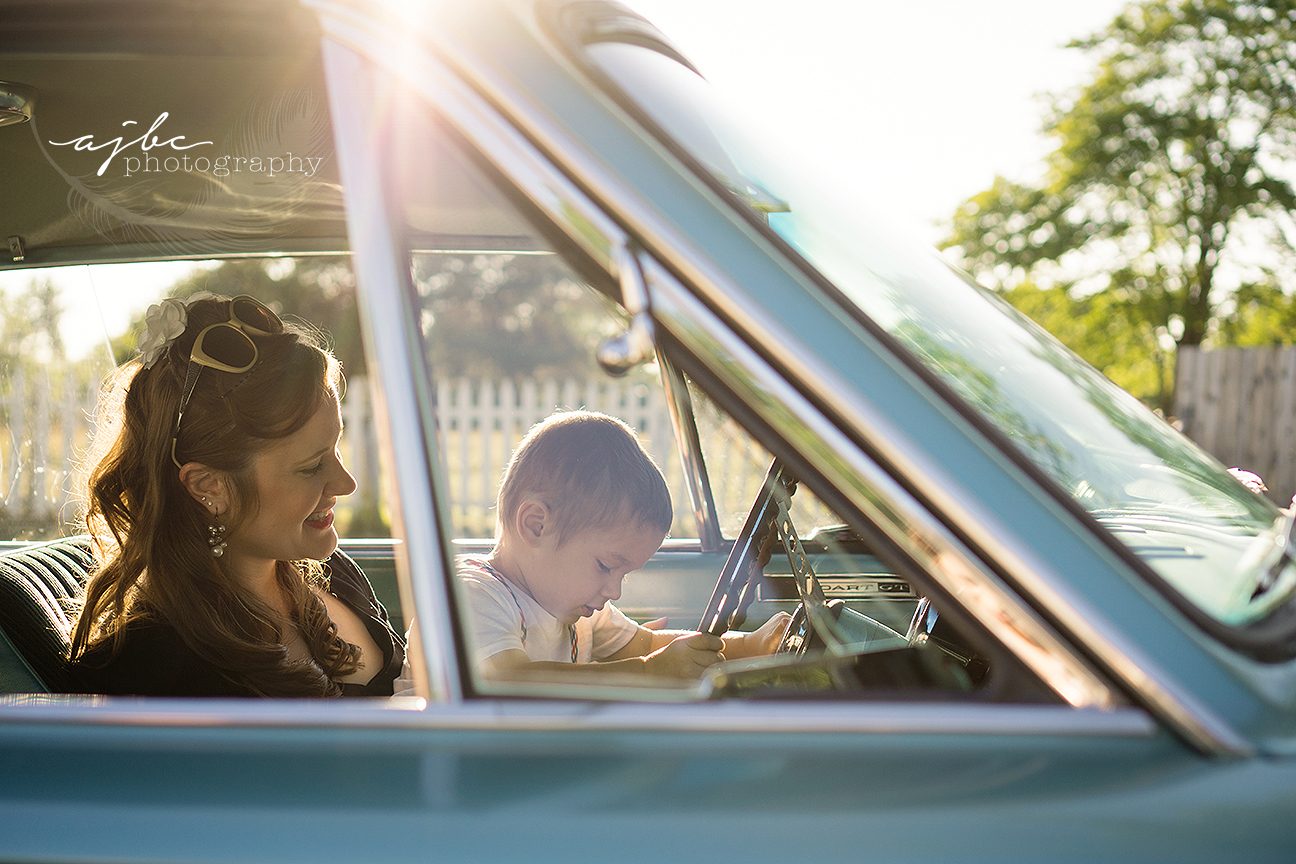 mom and son in a classic car outdoor family photoshoot.jpg
