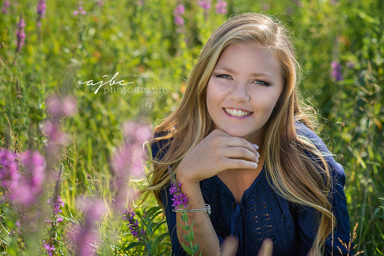 senior beauty in the flowers port huron michigan senior photographer.jpg