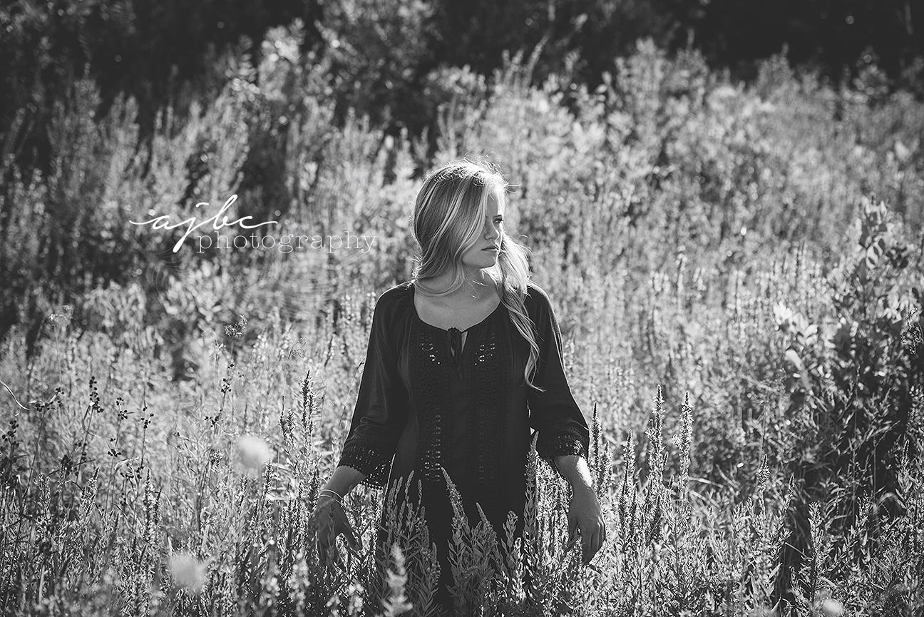 senior beauty in a field.jpg