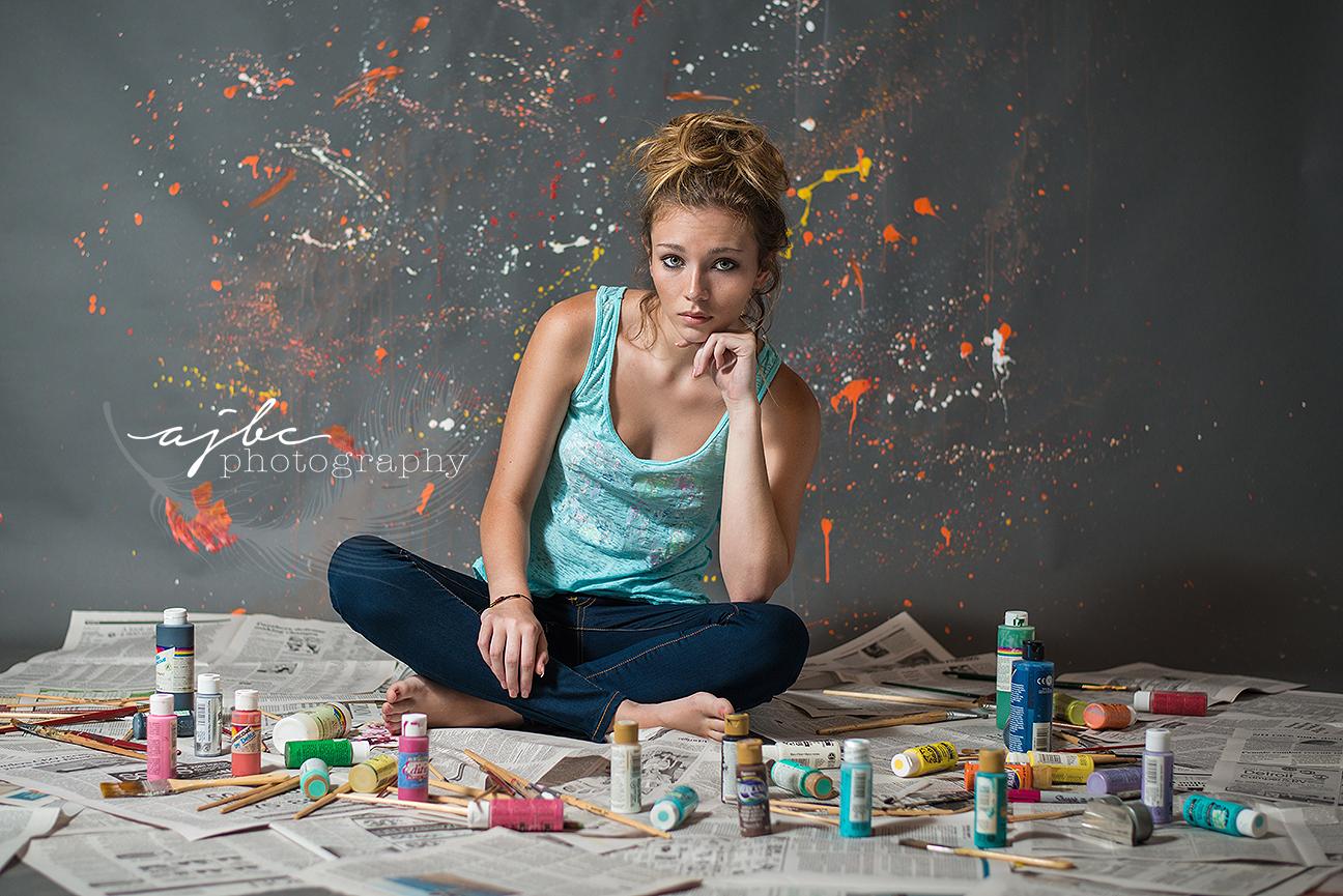 fun senior photoshoot throwing paint.jpg