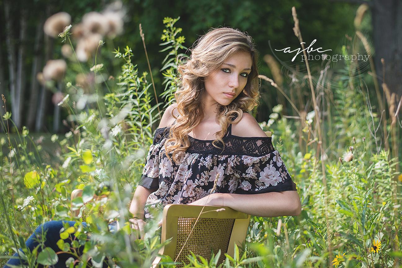 senior girl photoshoot in the flowers michigan photographer.jpg