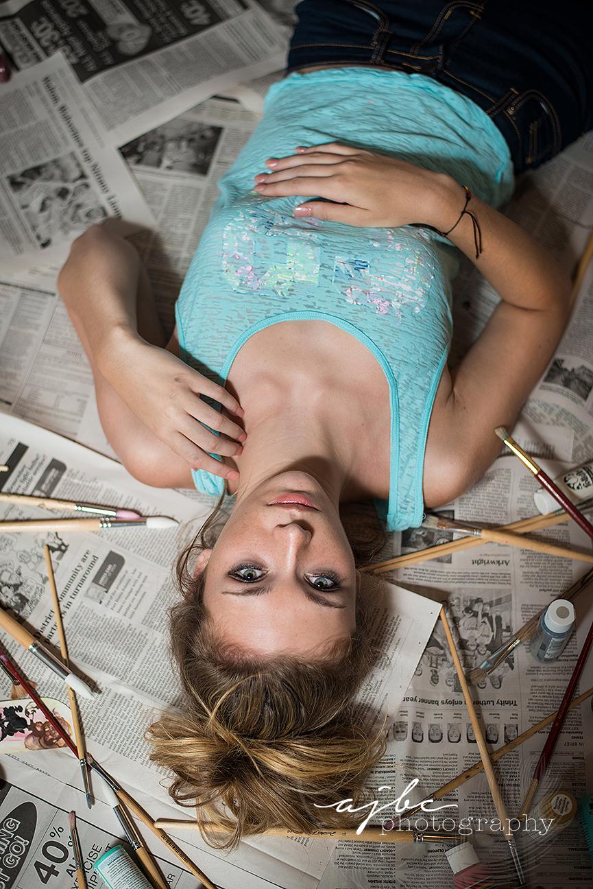 senior girl throwing paint michigan photographer.jpg