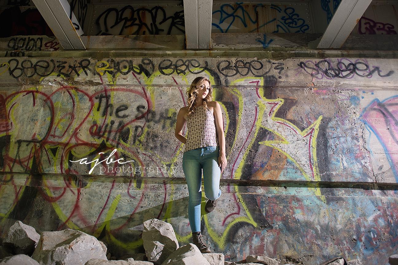 outdoor grungy graffiti senior girl photoshoot.jpg