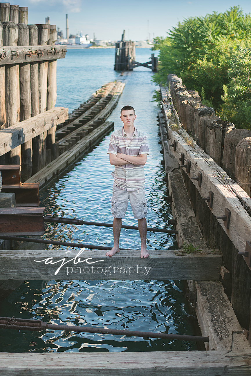 outdoor senior boy photoshoot on the water.jpg
